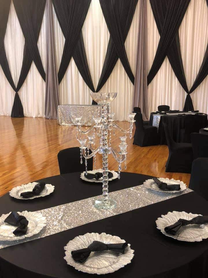 Black Majestic Tablecloths w/ Black Majestic Napkins and Black Spandex Chair Covers and Silver Sequin Runners