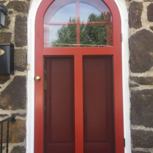 Round Top Wood Storm Door - A Pop Of Red For Your Home