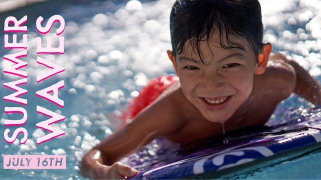 A kid enjoys the water on a floating device.