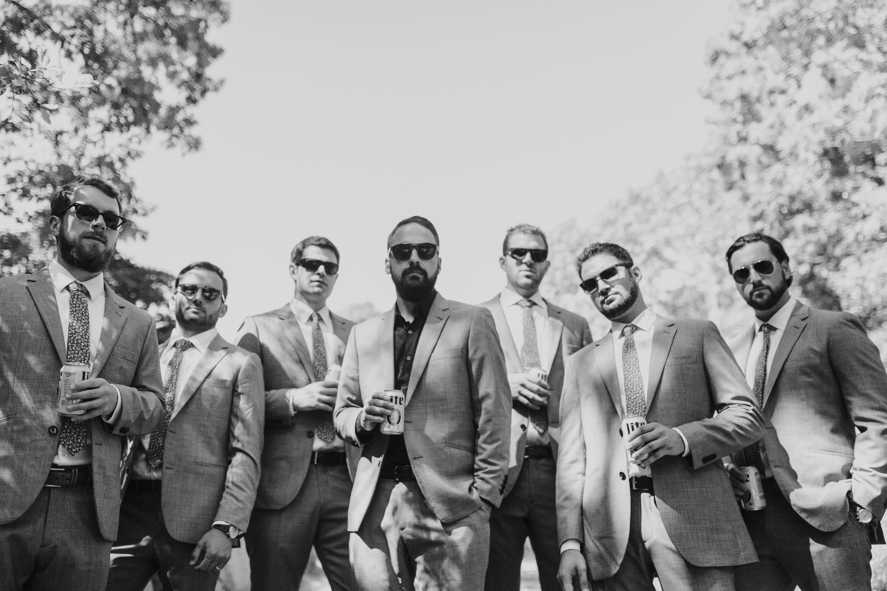 gq, beers bros and sunglasses, black and white picture of groom groomsmen and beer
