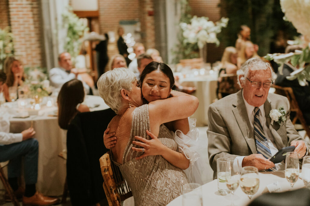 bride hugging guests