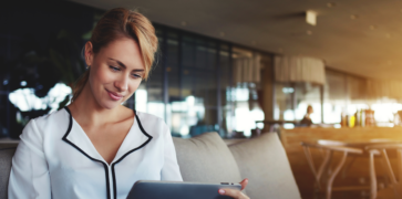 blonde woman on tablet investor relations websites