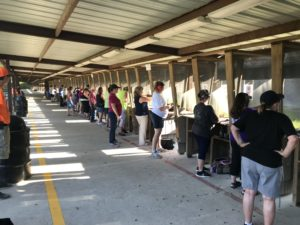 Patrons lined up at the pistol range in Cypress Texas