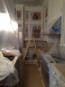 we used plastic to protect the appliances and counters while painting kitchen cabinets