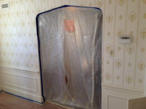 Photo of protection placed before changing the Brookline Colonial interior paint colors.