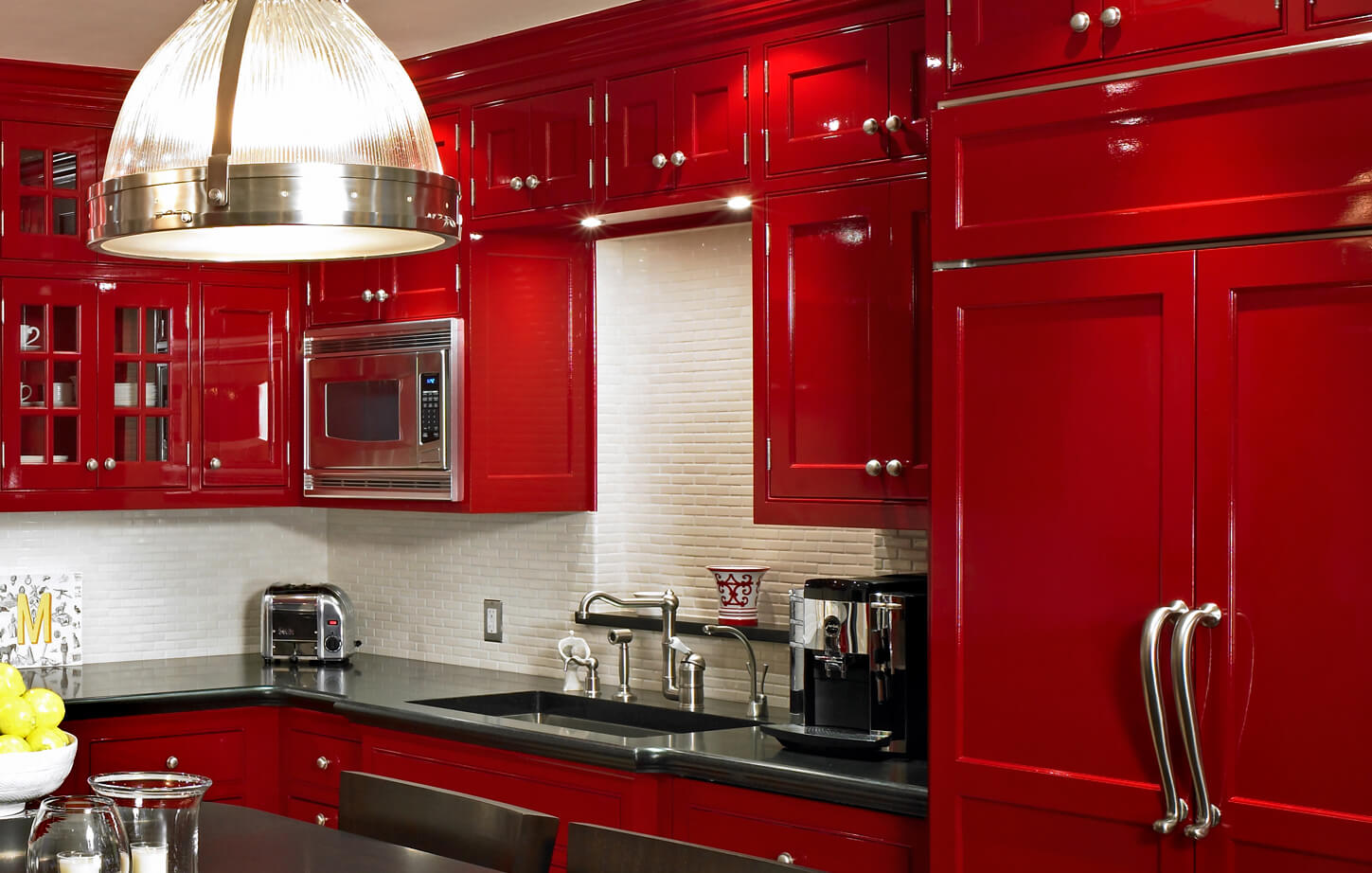 Red kitchen cabinets painted in Schreuder's Brilliant Gloss Rembrandt Red with a lacquer-like finish.