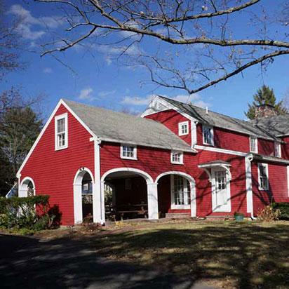 historic red home exterior painted