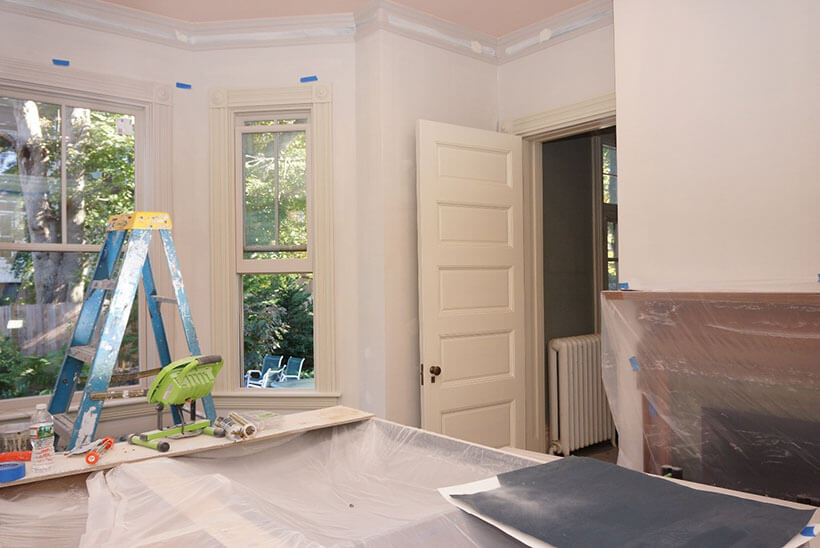 On going paint restoration work inside a kitchen