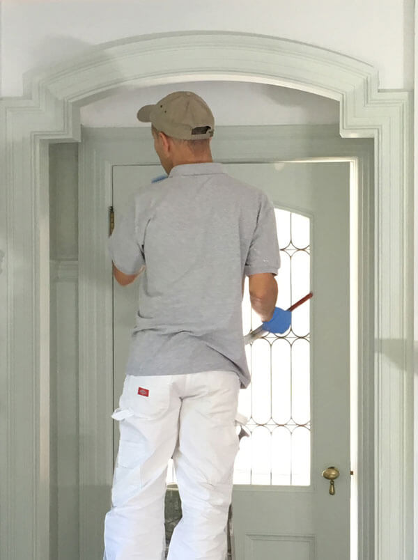 professional house painter using low voc paint