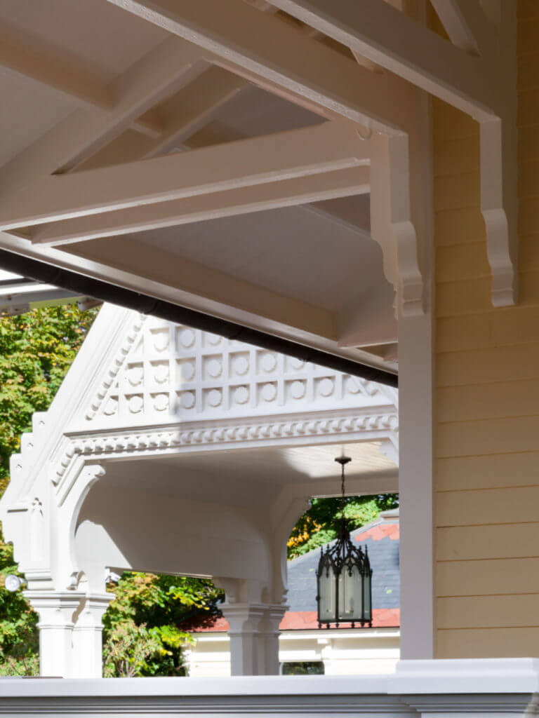 portico with triangular architecture featured at the top with yard view