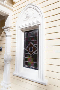 Windows on exterior of gothic victorian home upgraded
