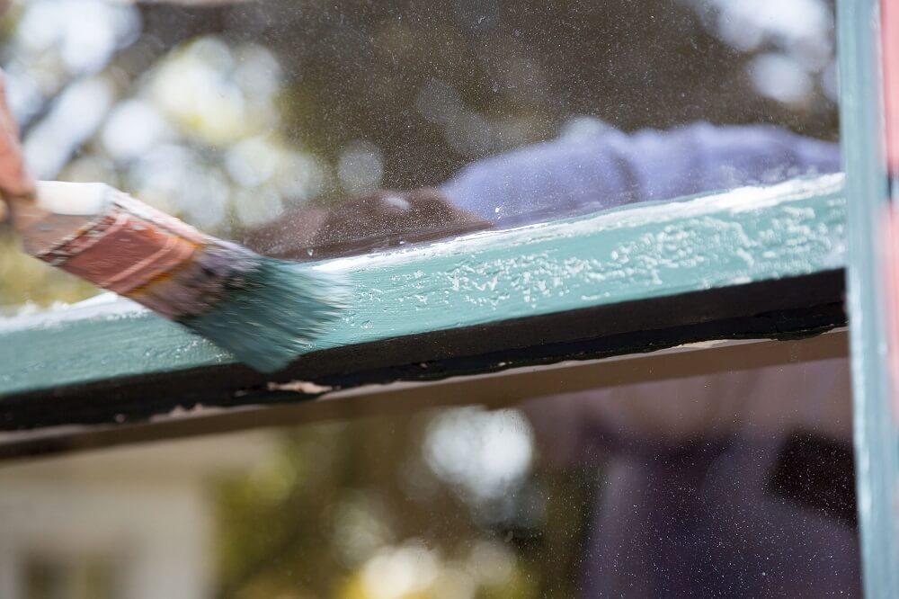 Bubbles under paint on a windowsill