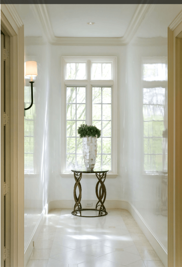 Choosing white interior paint for a foyer can be a bold choice.