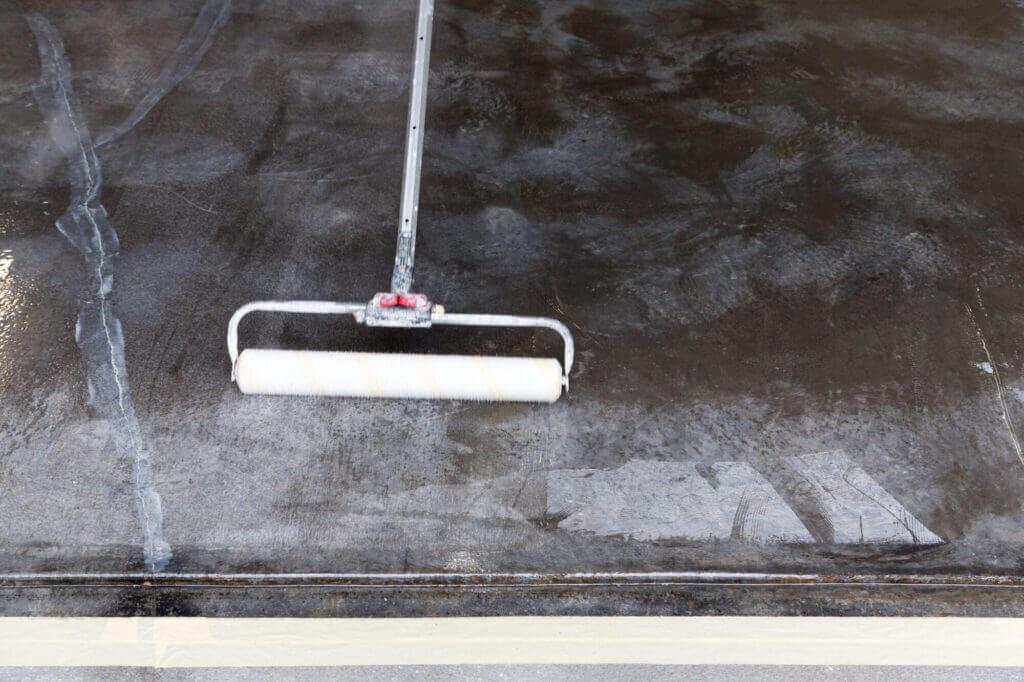 applying epoxy to garage floor