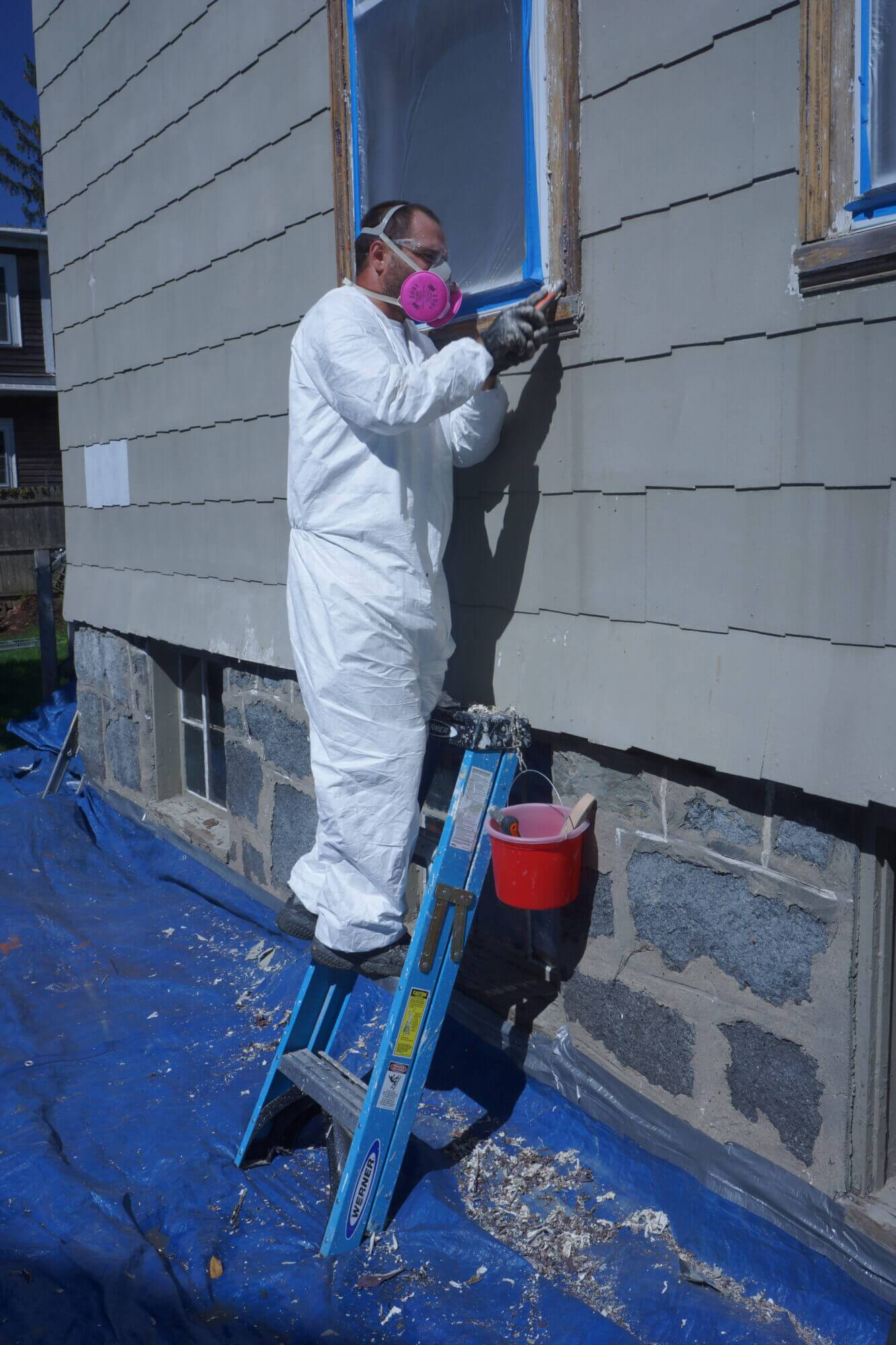 Catchlight employee working on trim of home exterior