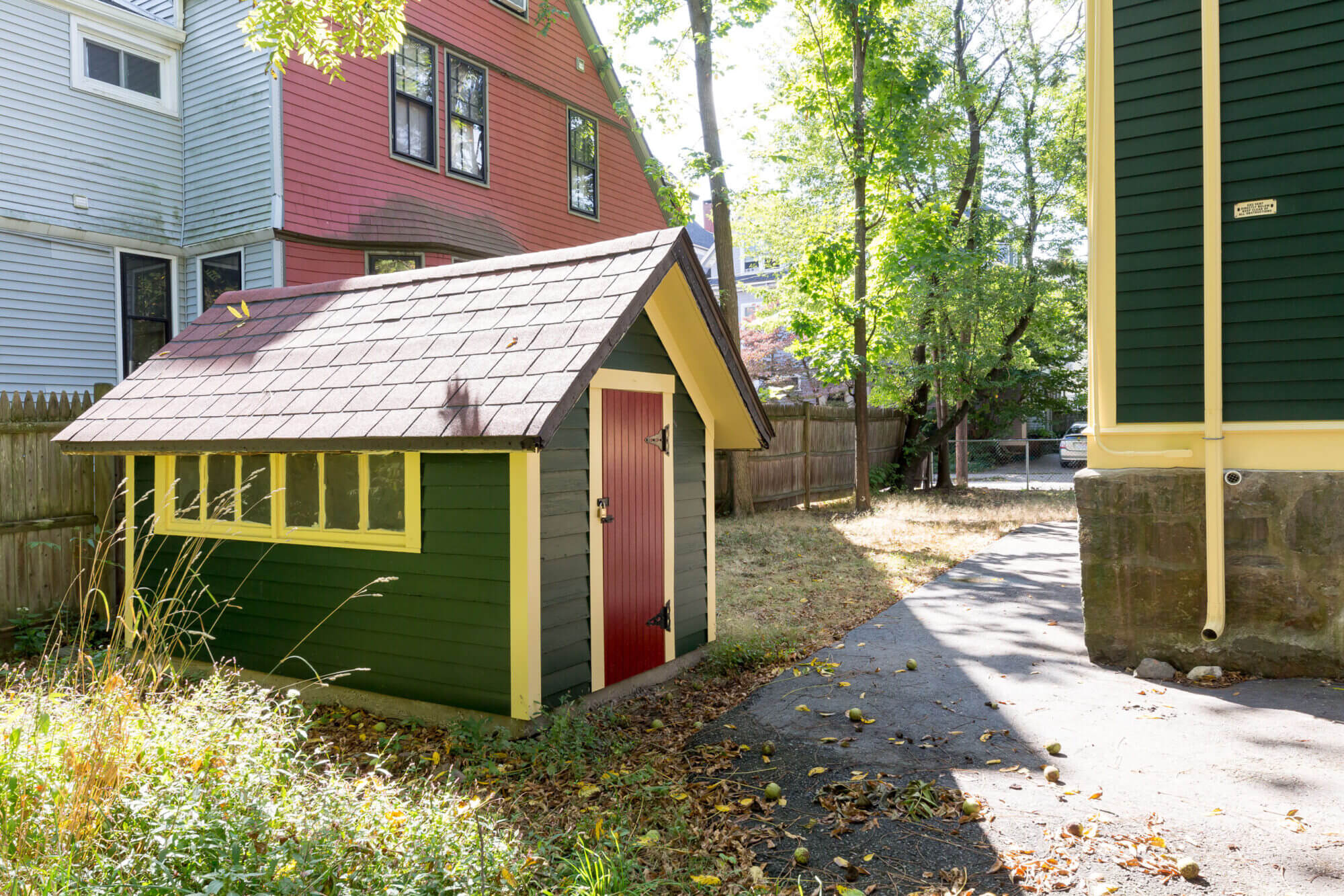 Freshly painted shed in the backyard of the Victorian home