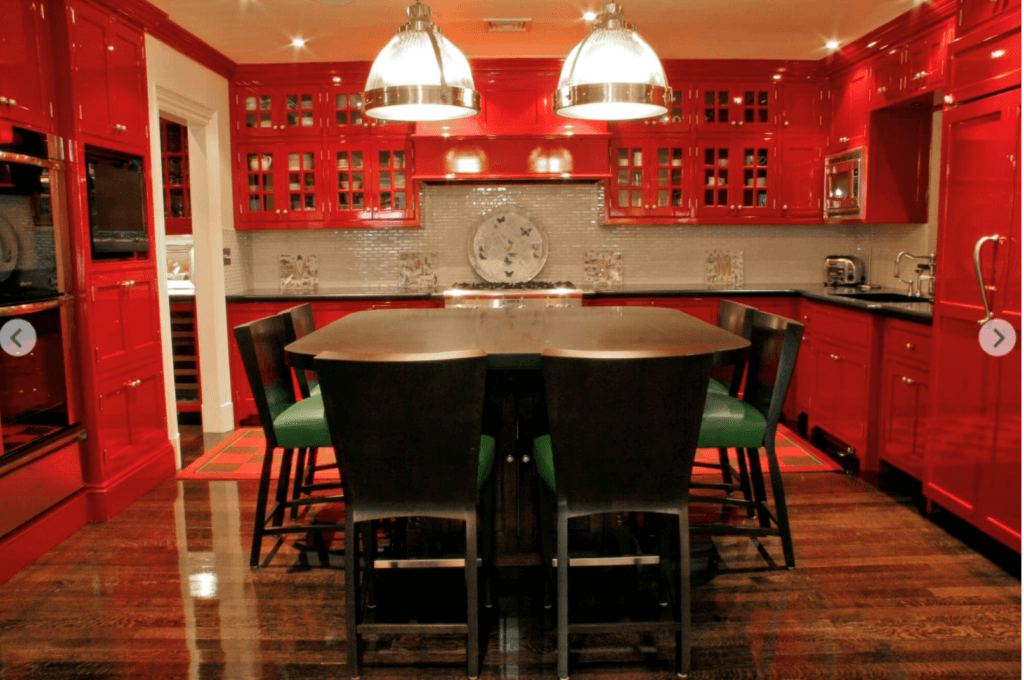 beautiful vibrant red kitchen in a historic New England home