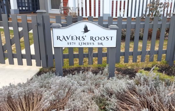 Entryway sign on gate