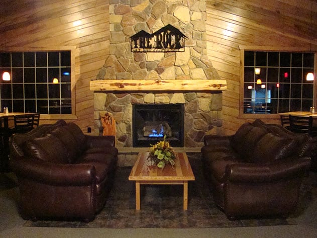 Waiting area with a fireplace and couches.
