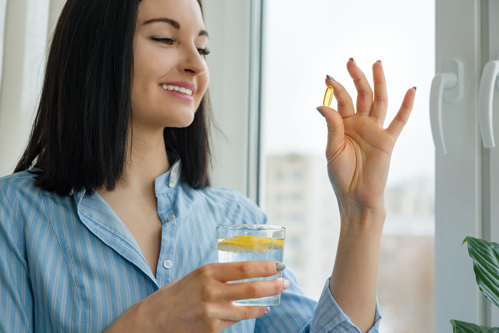 Woman taking nutritional supplement