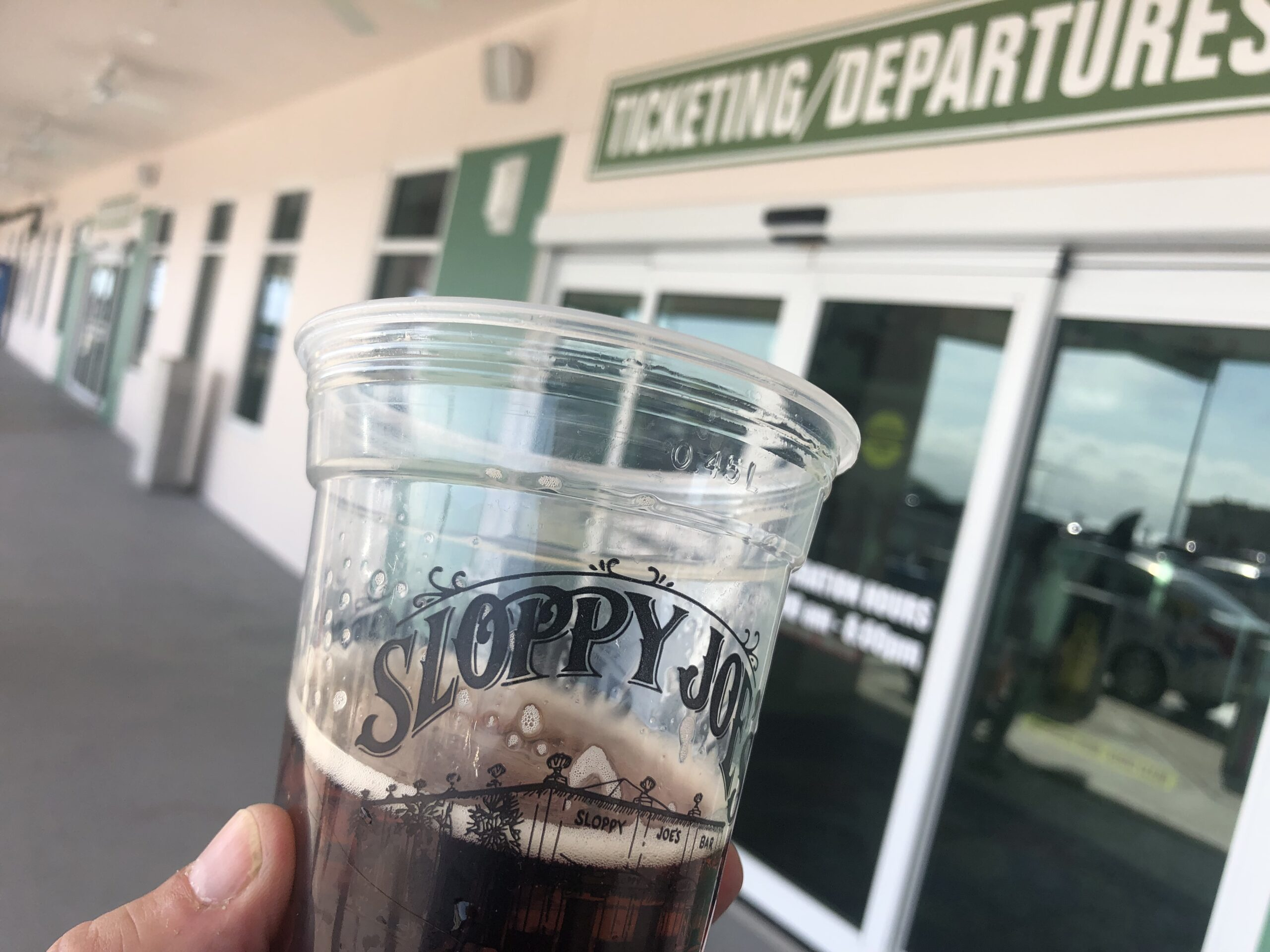 Nobody cares if you check into Key West airport drinking booze