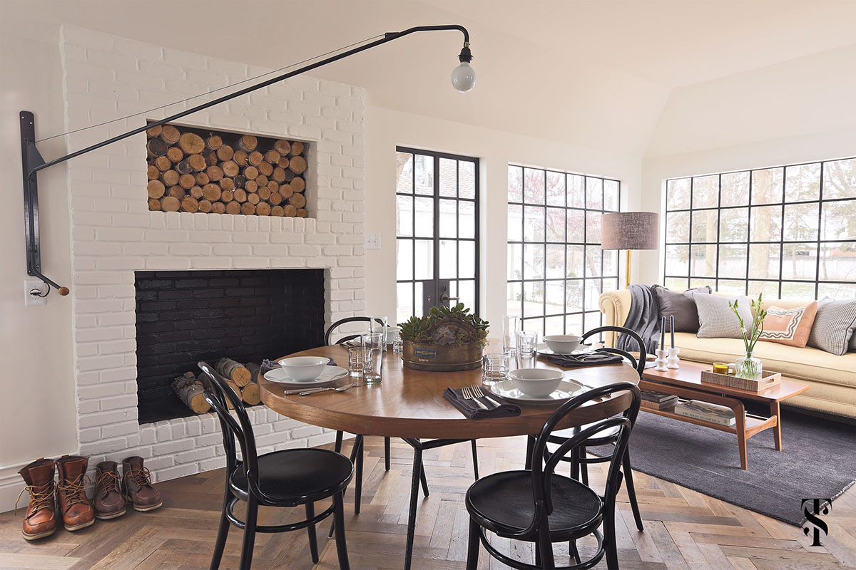 Country Club Tudor, Dining Table In Front Of Fireplace With Built-In Log Holder, Steel Frame Windows, Interior Design By Summer Thornton Design