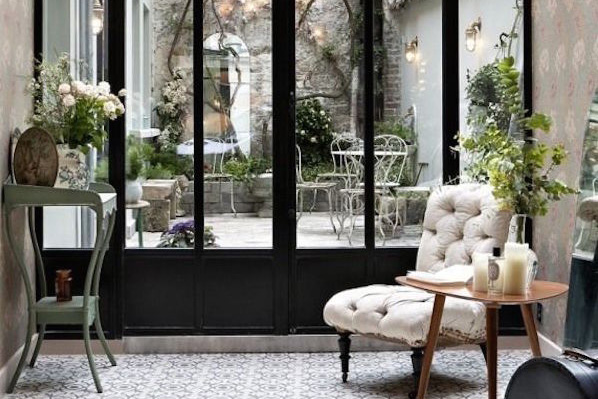 Parisian Interior sunroom with steel doors and steel windows in a sun room or greenhouse