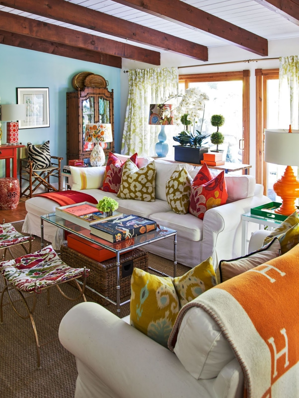 colorful living room with faux bamboo coffee table