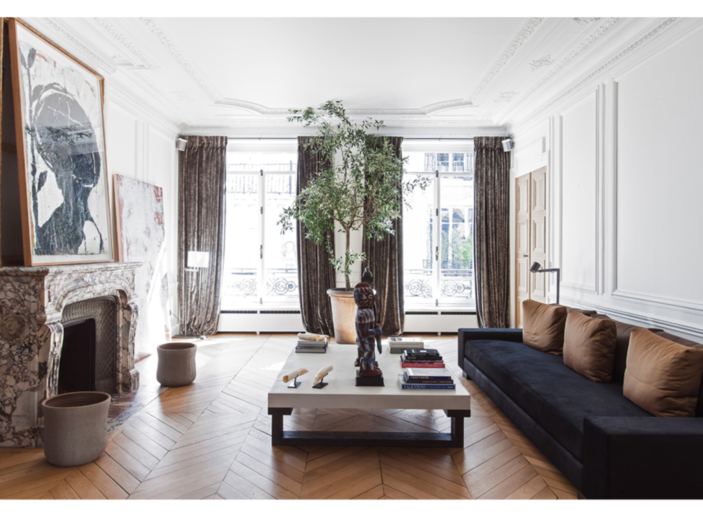 French Apartment Living Room with Coffee Table and chevron floors