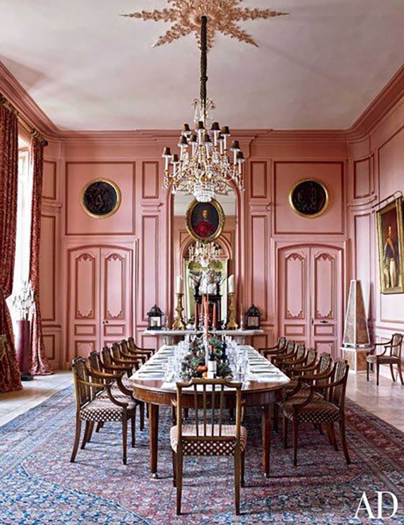 Timothy Corrigan pink and brass dining room via Architectural Digest