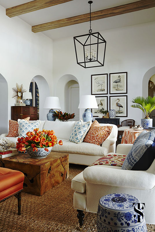 Naples Interior Design - interior designer Summer Thornton - great room with blue and white chinese pottery & orange pillows with audubon bird print artwork and white linen sofa with orange tulips - www.summerthorntondesign.com