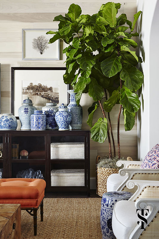 Naples Interior Designer - Summer Thornton - great room with blue and white Chinese ginger jars, a fiddle leaf fig tree, & vintage b&w photography with orange silk stool and wood paneled wall - www.summerthorntondesign.com