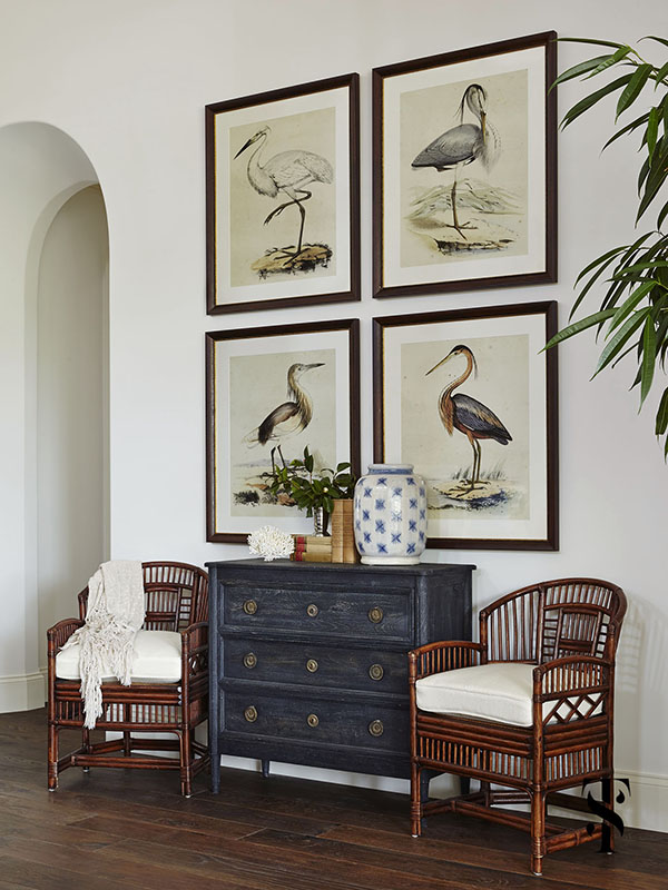 Naples Interior Design - interior designer Summer Thornton - audubon bird print artwork in a great room with cane chairs - www.summerthorntondesign.com