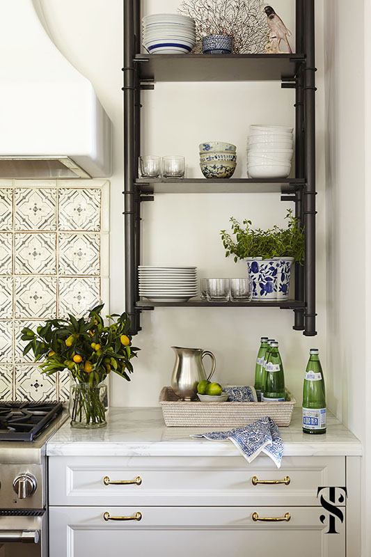 Naples Florida Kitchen Designer Summer Thornton - kitchen with wall mounted sleves, plaster hood and chinese pottery styled with kumquat branches and green bottles - www.summerthorntondesign.com