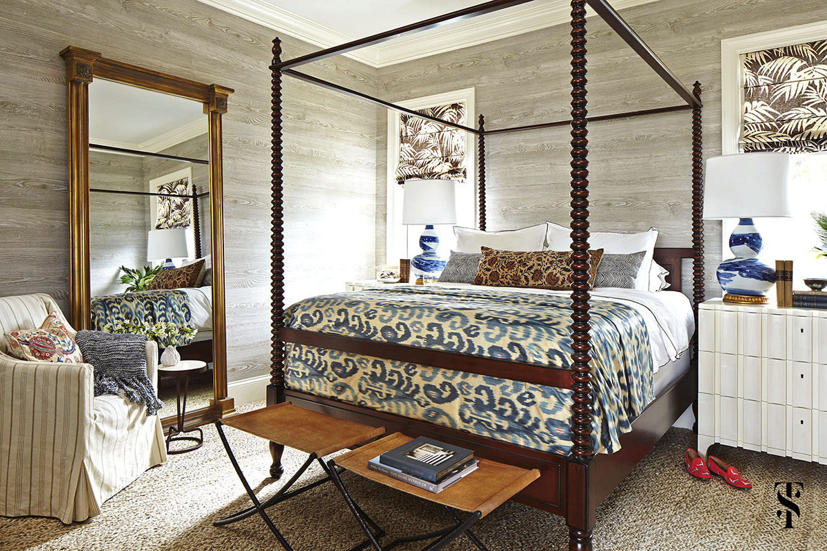 Naples Florida Interior Designer Summer Thornton - bedroom with faux bois wood walls by noblis and ikat throw with a four poster bed - www.summerthorntondesign.com