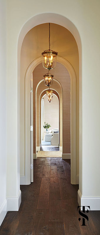 Naples Interior Design by interior designer Summer Thornton | interior architecture of curved doorways through hallway with grasscloth walls and glass lanterns | www.summerthorntondesign.com