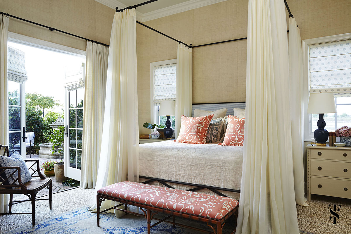 Naples Interior Designer Summer Thornton   bedroom with cream grasscloth walls and four poster bed opening to garden   www.summerthorntondesign.com