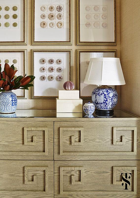 Naples Interior Designer Summer Thornton | bedroom with beige grasscloth walls and framed shells | www.summerthorntondesign.com