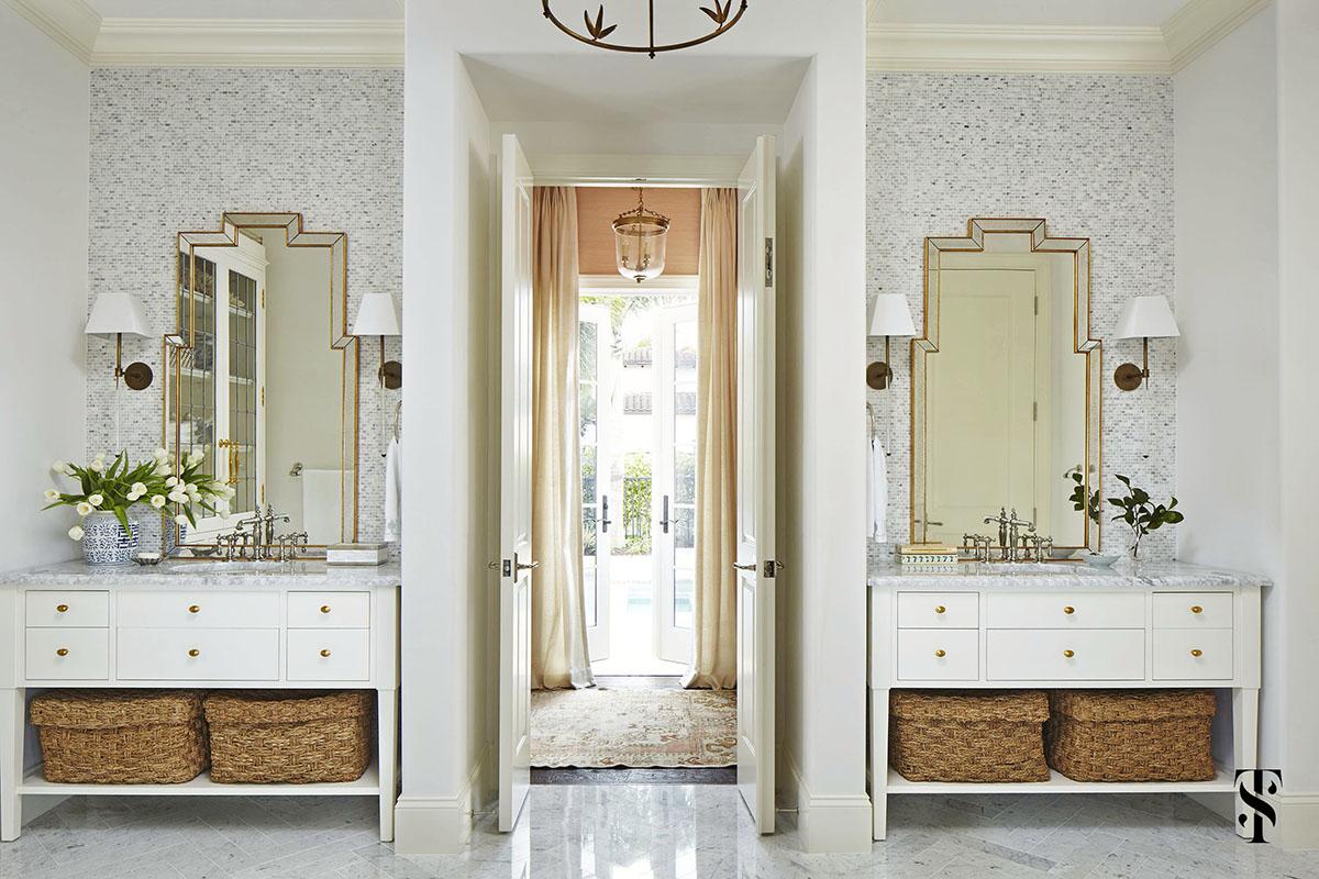 Naples Florida Interior Designer Summer Thornton   symmetrical white vanities in a marble bathroom steps from the pool   www.summerthorntondesign.com