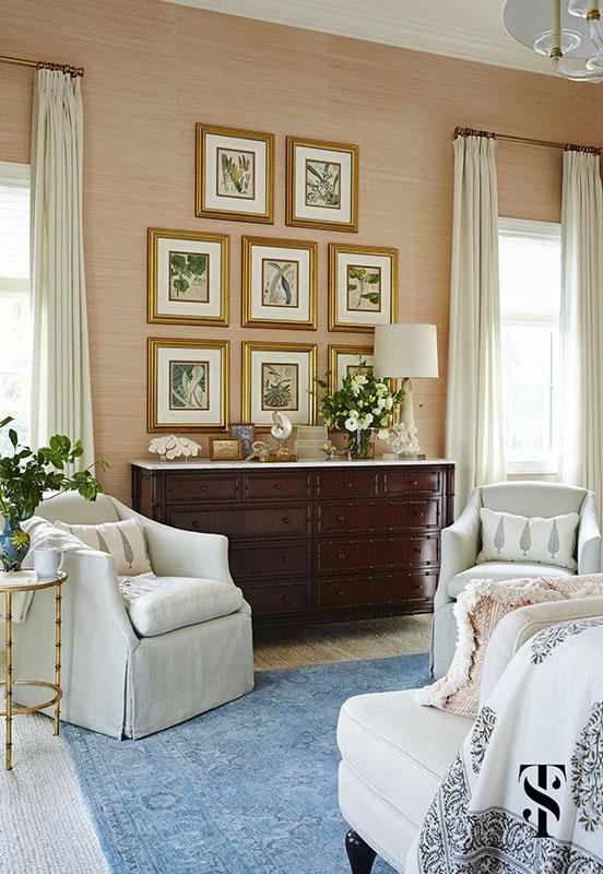 Naples Interior Design by interior designer Summer Thornton   bedroom with coral pink grasscloth walls and framed audubon floral prints   www.summerthorntondesign.com