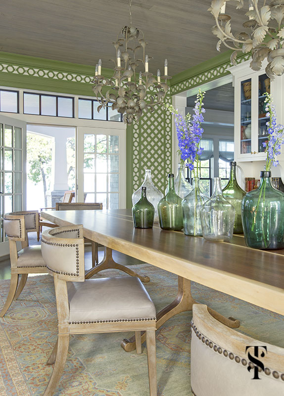 wisconsin lake house dining room in green trellis with live edge dining table, interior design by summer thornton www.summerthorntondesign.com