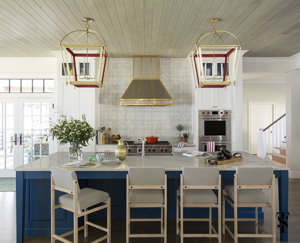 wisconsin lake house with wood ceiling, navy blue kitchen with pagoda style lanterns, and stainless steel and brass hood by rangecraft, interior design by summer thornton www.summerthorntondesign.com