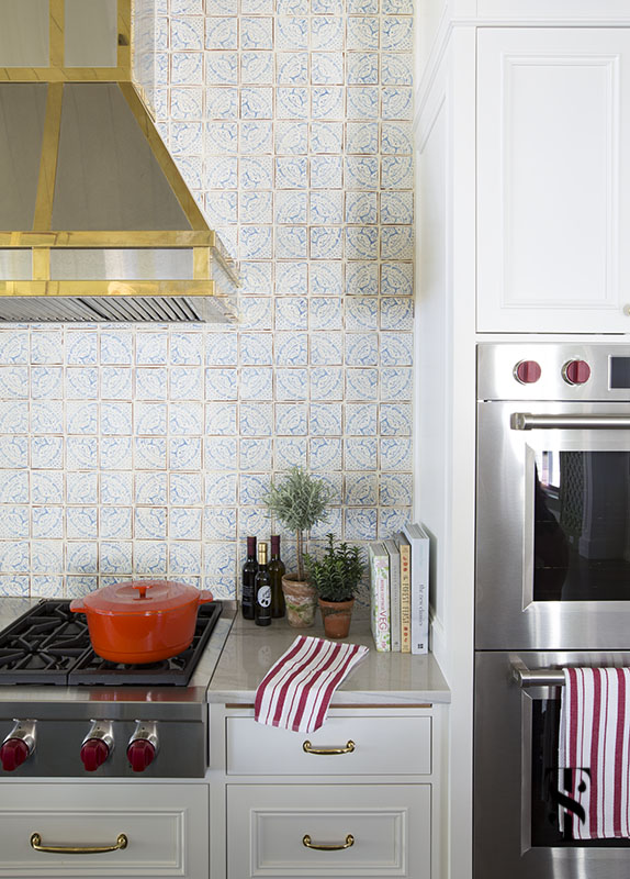 wisconsin lake house kitchen with stainless steel and brass hood by range craft & wall ovens by Wolf, interior design by summer thornton www.summerthorntondesign.com