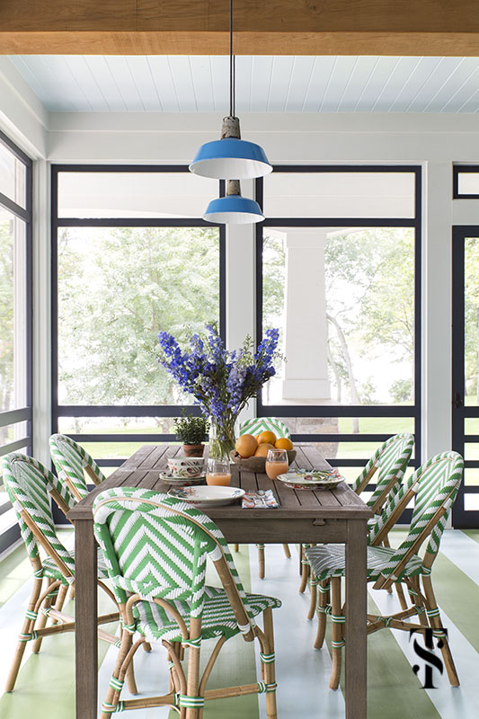 lake house porch with green striped floor and green bistro chairs by serena & lily, interior design by summer thornton www.summerthorntondesign.com