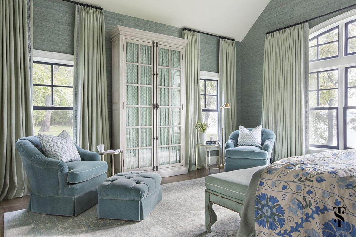green grasscloth walls and blue velvet reading chairs; interior design by summer thornton www.summerthorntondesign.com