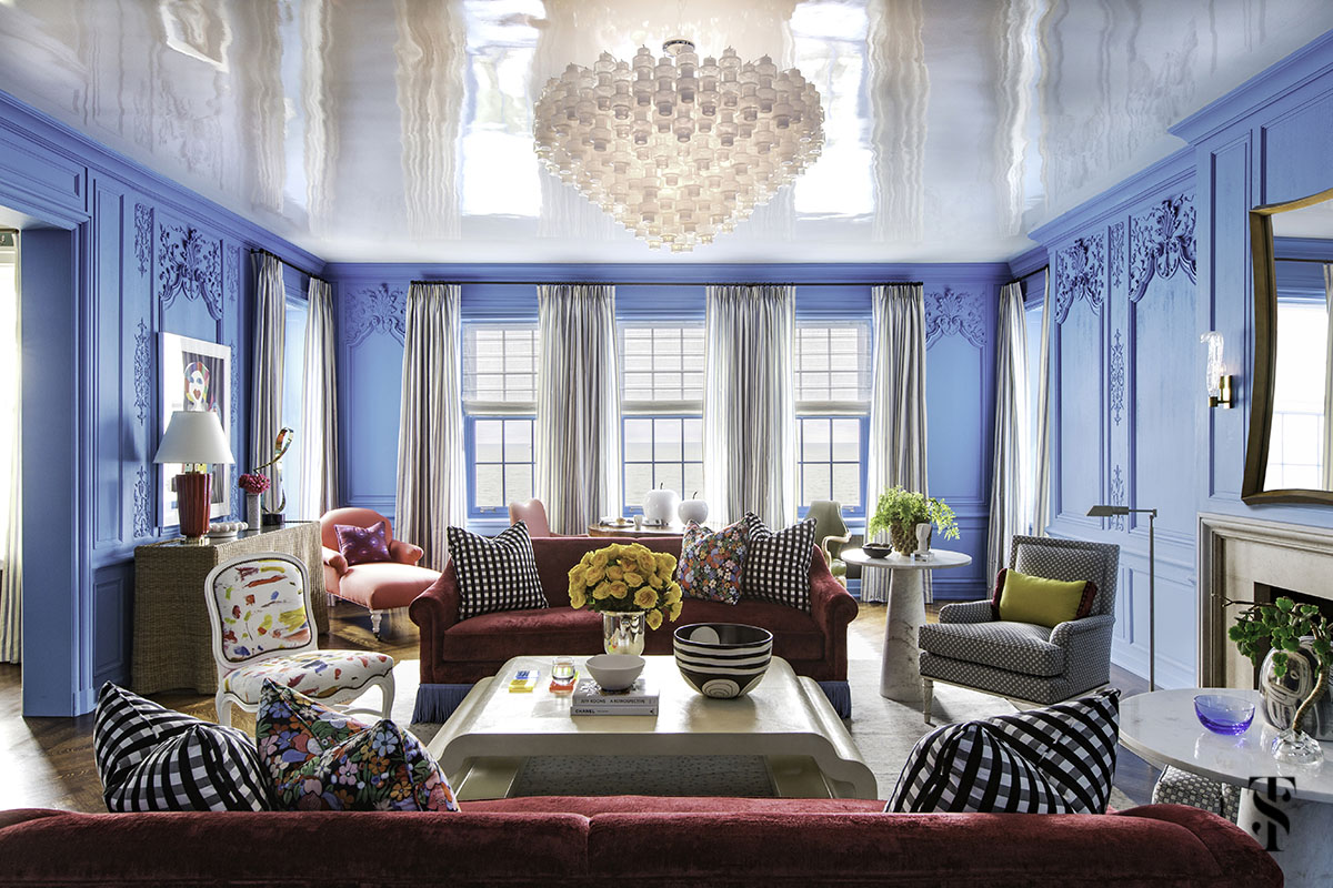 Chicago Co-Op at 1500 Lake Shore Drive interior design by Summer Thornton. Living room features farrow and ball St Giles blue, burgundy red silk velvet sofas, joan miro artwork, & more.