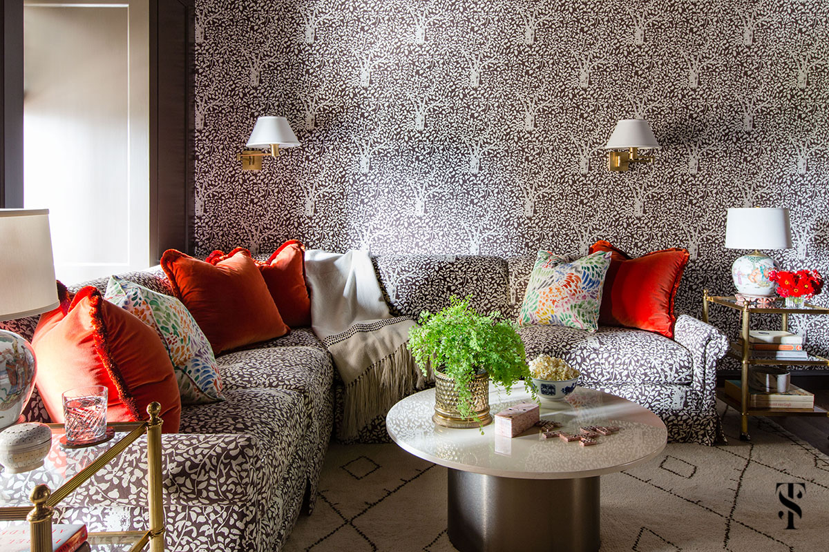 Interior design by Summer Thornton of a Chicago Co-Op at 1500 Lake Shore Drive. Family room features matisse tree pattern in matching wallpaper and upholstery.