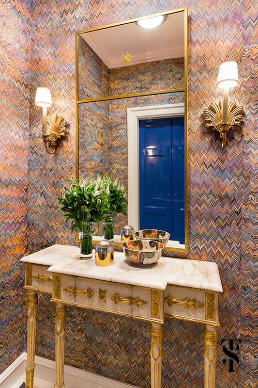 Interior design by Summer Thornton of a Chicago Co-Op at 1500 Lake Shore Drive. Elevator gallery & foyer features italian marbled paper wallpaper.