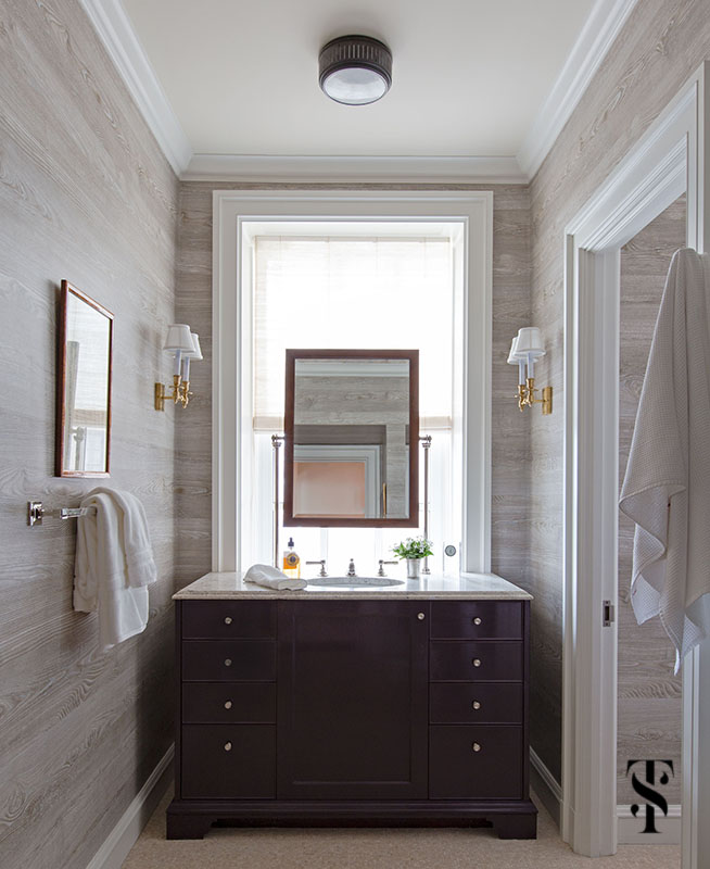 Interior design by Summer Thornton of a Chicago Co-Op at 1500 Lake Shore Drive. Bathroom features a faux bois wallpaper and masculine touches.