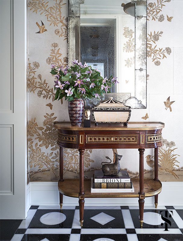 gracie wallpaper adorns the walls in an opulant foyer designed & remodeled by Summer Thornton complete with wild geometric patterned marble floor inspired by a palace. For more photos visit www.SummerThorntonDesign.com